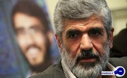 پدر شهید احمدی روشن: شجریان خیانت کار بود/ اگر تابلوی شجریان دوباره نصب شود مجددا آن را مخدوش میکنیم