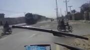 نجات معجزه آسای موتورسوار از مرگ در زیر قطار/ فیلم