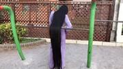 موهای دومتری دختری که ۱۵ سال موهایش را کوتاه نکرد / تصاویر