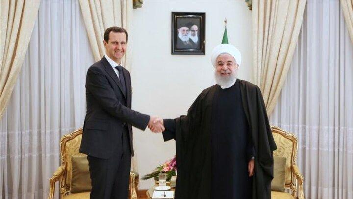 پیام تبریک روحانی به بشار اسد به مناسبت روز ملی سوریه