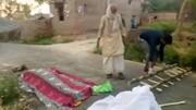 انتقال عجیب جنازه بیمار کرونایی با دوچرخه/ فیلم