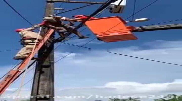 لحظه وحشتناک از حال رفتن نیروی امداد روی تیر برق! / فیلم