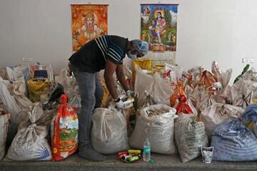 تصاویری هولناک از گونیهای حاوی بقایای اجساد فوتیهای کرونایی در هند