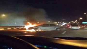 لحظه آتش گرفتن خودروی ال۹۰ پس از تصادف در تهران / فیلم