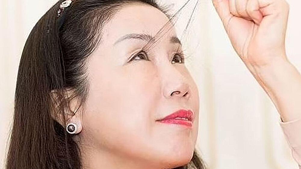 ثبت بلندترین مژههای زن چینی در کتاب گینس / عکس