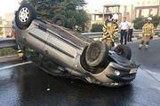 واژگونی خودروی پژو ۲۰۶ در بزرگراه شهید حقانی / فیلم