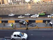 اتفاق عجیب در بزرگراه امام علی تهران / خودروی ساندرو از آسمان به زمین افتاد! + عکس
