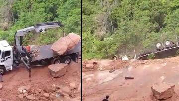 سقوط وحشتناک کامیون به داخل دره هنگام بلند کردن سنگ بزرگ با جرثقیل! / فیلم