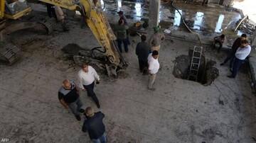 کشف ۲۰۰ کیسه اسکناس از زیر آوار شعبه بانک مرکزی عراق / فیلم